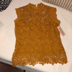 Beautiful golden  lace top size xs